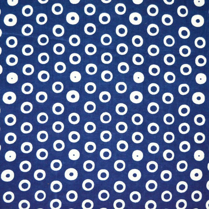 White circular motif design with blue dyed cotton fabric